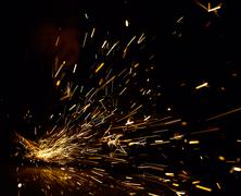 Sparks in the dark Stock Photos