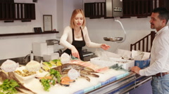 Shop employee selling fresh fish Stock Footage
