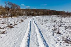 Snow track in the field Kuvituskuvat