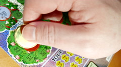 Close up man scratching lottery ticket with 4k resolution Stock Footage
