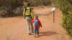 A family hiking in Kodachrome Basin State Park Utah gimbal shot - stock footage