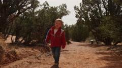 Boy hikes at Kodachrome Basin state park gimbal shot Stock Footage