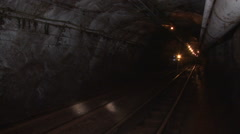 Trolley in the mine goes on rails  Stock Footage