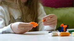 Child sculpts from colored dough. Stock Footage