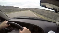 A timelapse of a man driving through desert road Stock Footage