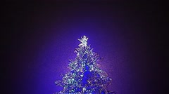 Christmas Tree in Snowy Night-Wide Shot Stock Footage