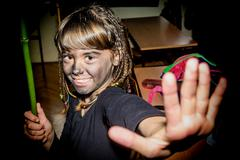 Portrait of a happy little girl with face painted with charcoal for maskenbal Stock Photos