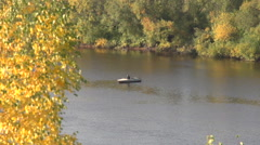 Big river and fishman on a boat Stock Footage