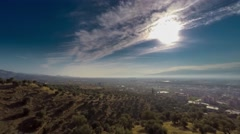 Sunrise over a small town. Overlooking of valley with rolling green hills and - stock footage