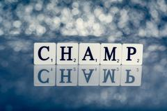Written word of tiles with letters - champ Stock Illustration