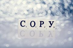 Written word of tiles with letters - copy Stock Illustration