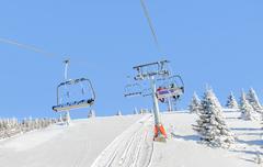 Ski lift with chairs in Kopaonik resort in Serbia Stock Photos