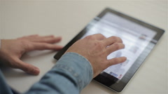 Man hand using tablet computer pc computer in background Stock Footage
