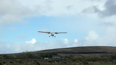 Small plane approaching runway very low Stock Footage