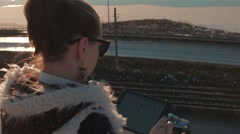 Girl playing tablet Stock Footage