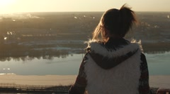 The girl looks at the city skyline Stock Footage