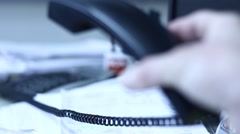 Telephone handset in office - stock footage