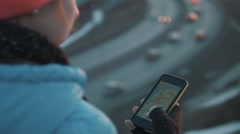 The girl uses a phone at sunset Stock Footage