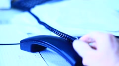 Holding telephone handset in a palm hand in the office Stock Footage