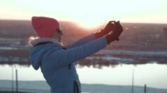 Girl makes a selfie at sunset Stock Footage