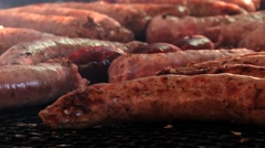 People cook sausages at the street during Medieval festival in Montblanc, Spain. Stock Footage