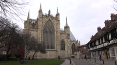 York Cathedral car pass on cobblestone road England 4K Stock Footage