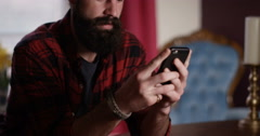 4k, Man sitting at home with his mobile phone. Stock Footage