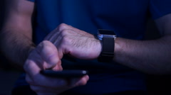 Man  connected, sliding   and used smartphone and smartwatch Stock Footage