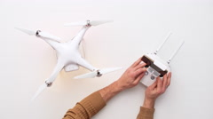 Man installing dron at his office desk. Upview Stock Footage