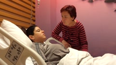 Mother speaks with her daughter after surgent Stock Footage