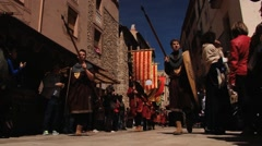 People take part in the procession during Medieval festival in Montblanc, Spain. Stock Footage