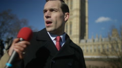 4K Man in business dress in London being bothered by news reporters - stock footage
