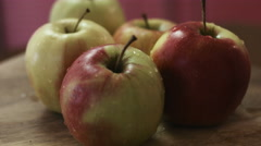 Fresh tasty apples just washed and still wet because of a water, wooden Stock Footage