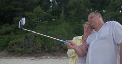 Couple with Smartphone and Selfie Stick Stock Footage