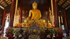 Buddha in Wat Phan Tao. Zoom in. - stock footage