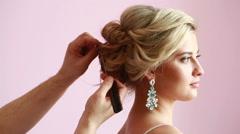 Bride at hairdressing salon making wedding headdress Stock Footage