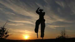 Stilt Walker Dancing at Sunset. Amazing Show. Action in Slow Motion. Stock Footage