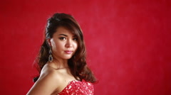 Beautiful asian woman model portrait in hot red dress Stock Footage