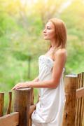 Gentle woman on terrace - stock photo