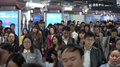 Commuting subway passengers exit metro at station in Shanghai, China Stock Footage