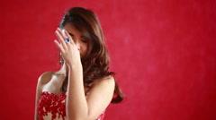 Beautiful asian woman model portrait in hot red dress - stock footage
