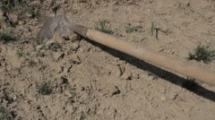 Farmer handles hoe very dry soil Stock Footage