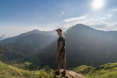 Man Standing at the Edge of Little Adam's Peak - stock photo