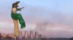 Stilt Walker Crash the Buildings. - stock footage