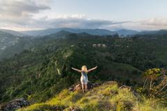 Woman standing at the edge of a hill Stock Photos