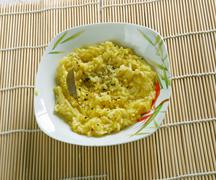 Puliyogare tamarind rice - stock photo