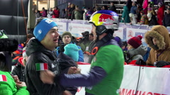Friends and colleagues congratulate the winner of the snowboard slalom. Stock Footage