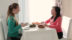 Two young women talking over coffee. Breakfast two young woman. Young woman Stock Footage
