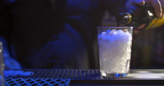 Bartender making alcoholic cocktail Stock Footage