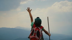 Little hiker standing on top of a mountain 2 - stock footage